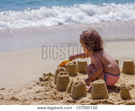 Little Girl Playing On The Beach