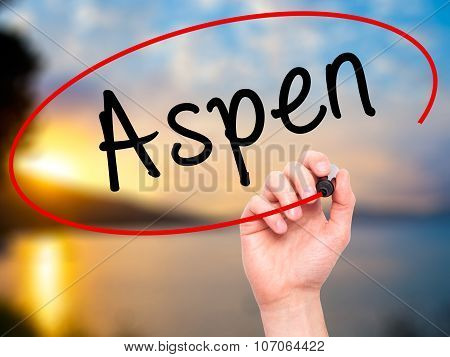 Man Hand writing Aspen with black marker on visual screen.