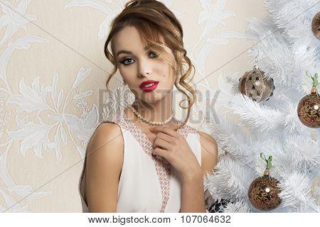 Fashion Woman Near Christmas Tree