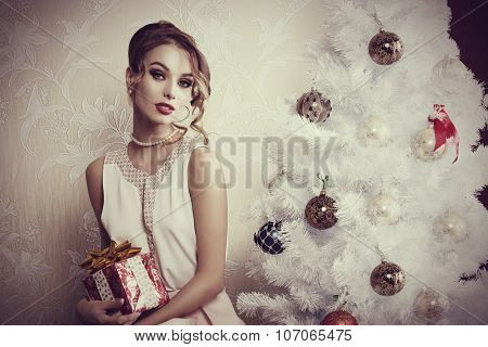 Elegant Girl Near Christmas Tree