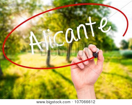 Man Hand writing Alicante with marker on visual screen.