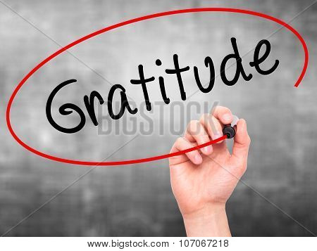 Man Hand writing Gratitude with black marker on visual screen