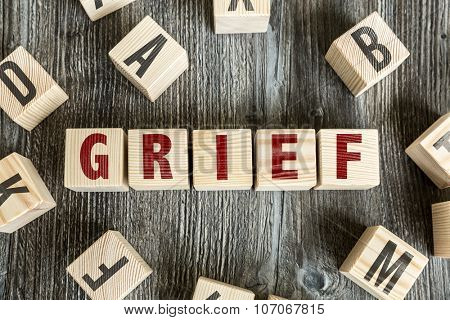 Wooden Blocks with the text: Grief
