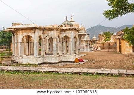 Indian Women Sleep Near The Gaitore Cenotaphs With Typical Rajasthani Carvings
