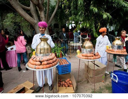 Men In Traditional Rajasthan Dresses Prepare Tea Masala During The Festival In India