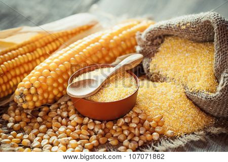 Corn Groats And Dry Seeds, Corncobs On Wooden Rustic Table.