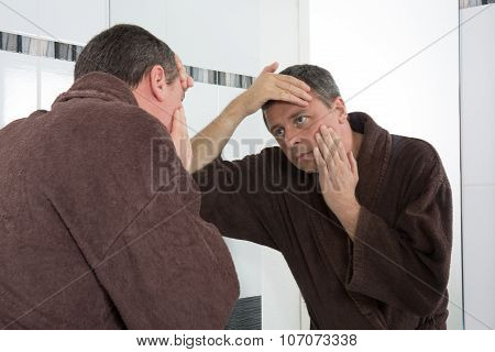 Middle-aged Man In Bathroom