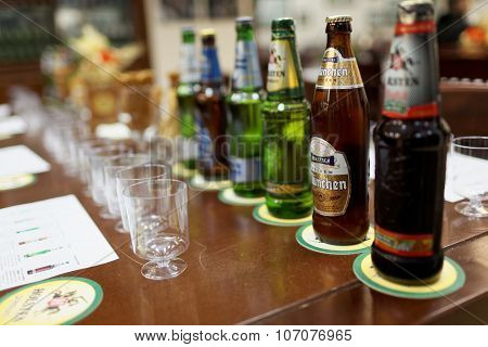 ST. PETERSBURG, RUSSIA - OCTOBER 24, 2015: Beer bottles at the table during tasting session in the Baltika - St Petersburg brewery. This session is a part of the October Beer Festival celebrations