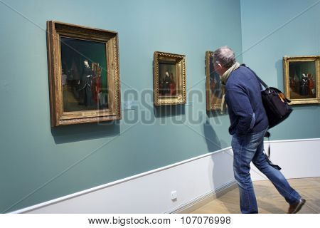 ST. PETERSBURG, RUSSIA - OCTOBER 22, 2015: People in the exhibition of Pavel Fedotov, 1815-1852, in the Russian Museum. The exhibition is dedicated to 200th anniversary of the painter
