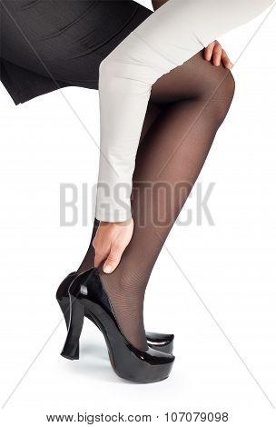 Women Wearing High Heels Black Shoes Massaging Tired Legs