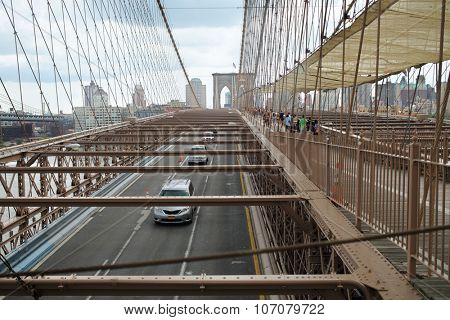 NEW YORK, USA - SEP 08, 2014: Driving and walking part of the Brooklyn Bridge in New York City, top view