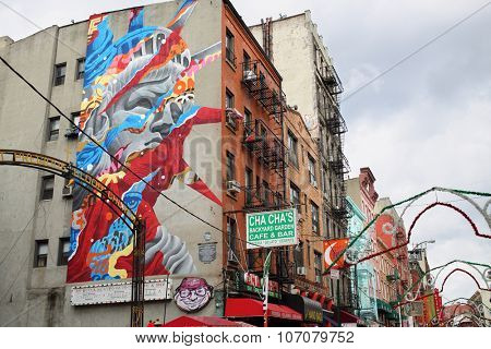 NEW YORK, USA - SEP 08, 2014:  Color portrait of the Statue of Liberty on a building in Chinatown in New York