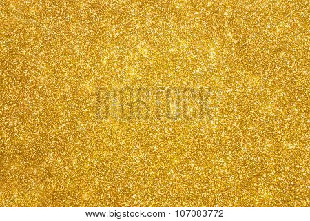 Golden glitter christmas abstract background. Shiny golden lights