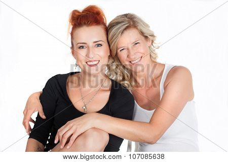 mother and daughter relationships. family. two beautiful women sitting together. generation, joy, ti