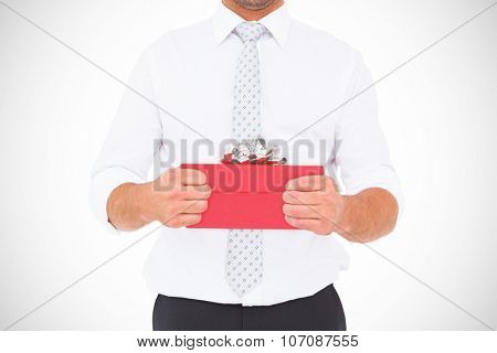 Businessman holding his hands out against present