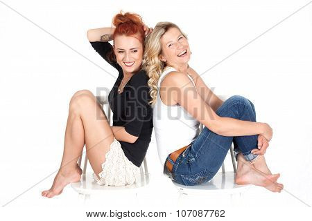 mother and daughter relationships. family. two beautiful women sitting together.