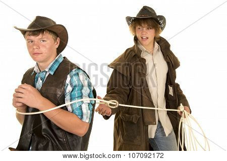 Young Cowboy Ropes Another Cowboy