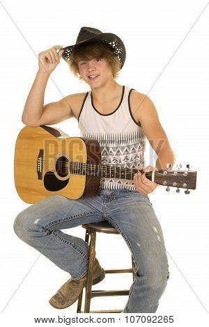 Young Man Playing A Guitar With Cowboy Hat Looking