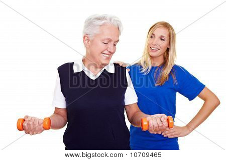 Elderly Woman With Personal Trainer