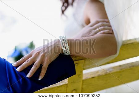 The Hands Of Bride And Groom