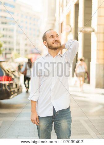 Carefree man walking downtown Madrid