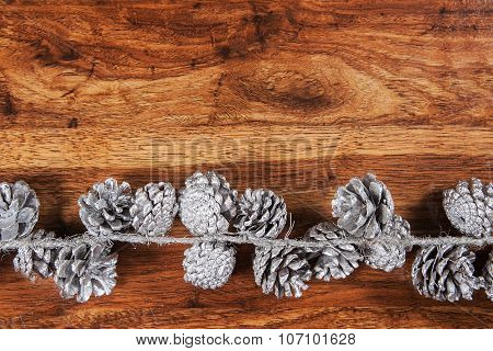 Rustic wood background with Christmas pine cones