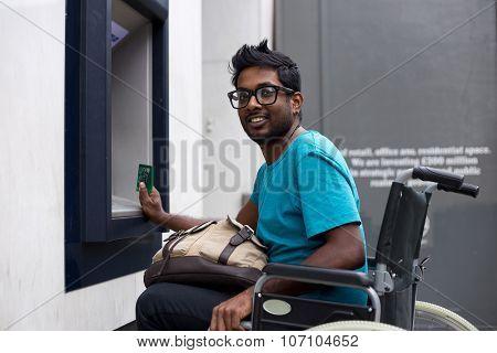disabled man at atm