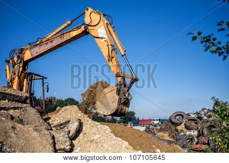 Construction Site Digger, Excavator And Bulldozer. Industrial Machinery On Building Site