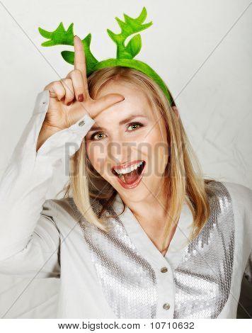 Reindeer Hat On Fun Woman.