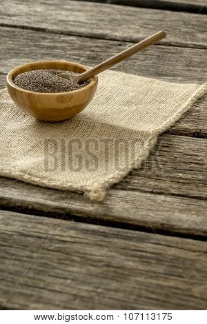 Chia Seeds In A Wooden Bowl With Wooden Spoon In It