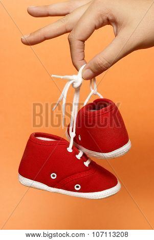 Holding Baby Shoes