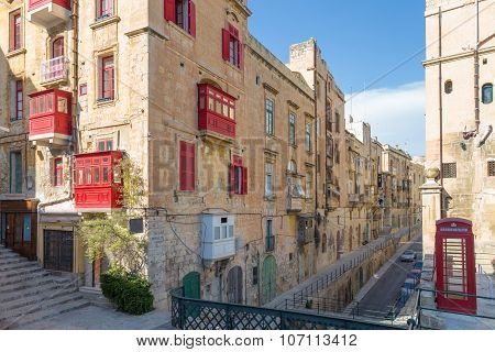 Streetview of Valletta with red phonebooth, Malta