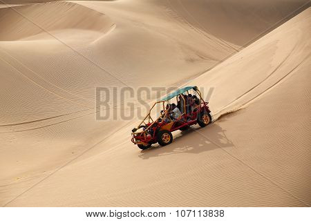 Huacachina, Peru - January 23: Unidentified People Ride In Dune Buggy (blurred Motion) In A Desert O