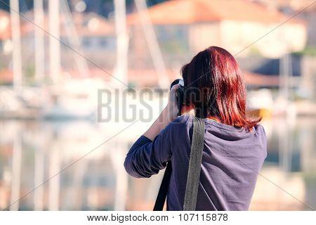 Girl photographs Bay of Kotor, Montenegro