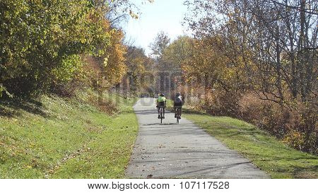Two Men on Bikes on a Trail.