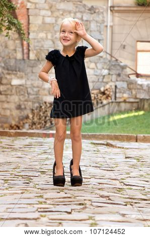Little Girl Dressed Like An Adult Woman