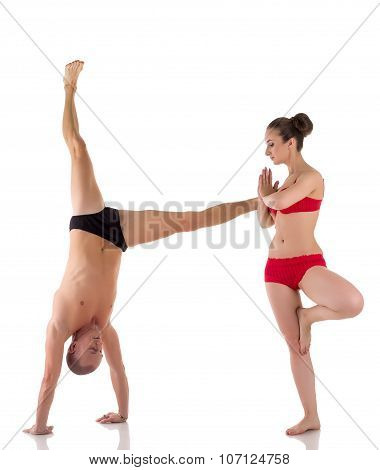 Paired yoga. Letter H formed by people bodies