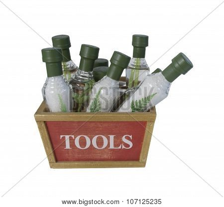 Cone-shaped Bath Salt Bottles In A Wooden Tool Box
