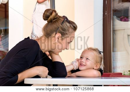 Mother And Daughter Spend Time In Cafes