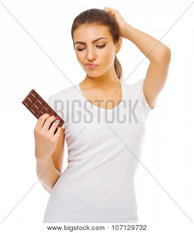 Doubting young girl with chocolate isolated