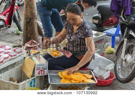 VIETNAM - JUNE 10, 2015: An unidentified woman peels and sells durian fruit. Regarded by locals as the