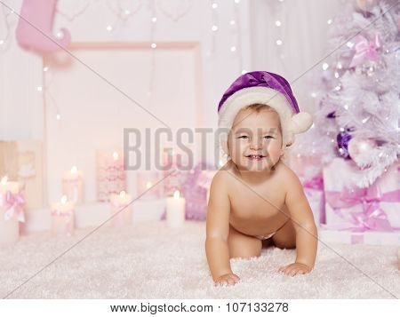 Christmas Baby In Santa Hat, Kid In Decorated Xmas Pink Background, Child