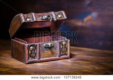 Beautiful Retro Chest With Open Lid On Wooden Background With Place For Text, Closeup