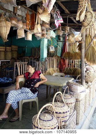 woman sells different kinds of handicraft and home products