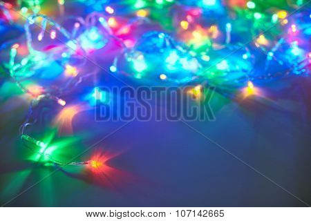 Christmas Lights On Dark Blue Background With Copy Space