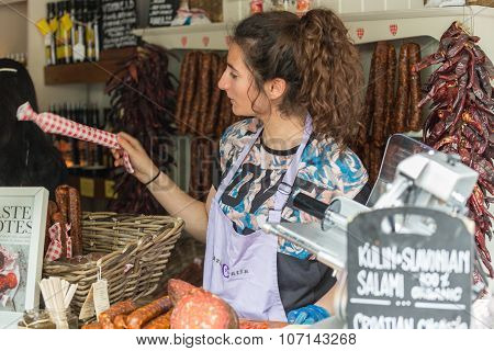 LONDON - JUN 12, 2015: Homemade meat loaf (sausage) at organic farmers' Sunday market. Borough marke