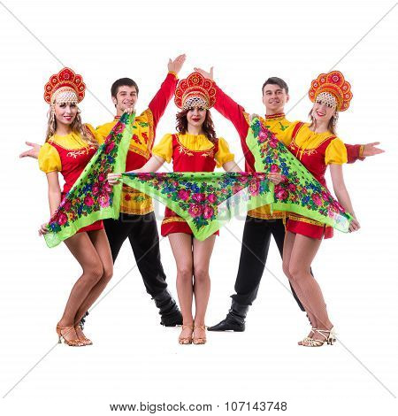 Dancer team wearing a folk costumes isolated on white