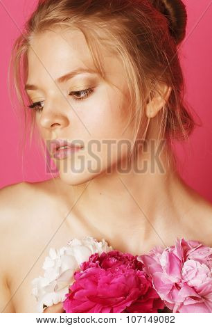 young beauty woman with flower peony pink closeup makeup soft tender gentle look