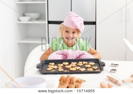 Happy Little Girl Holding A Plate With Her Cookies Ready To Eat