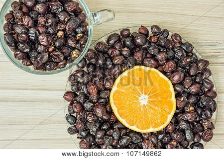 Dried Rosehips And Sliced Orange Arranged In The Two Bowls, Healthy Lifestyle